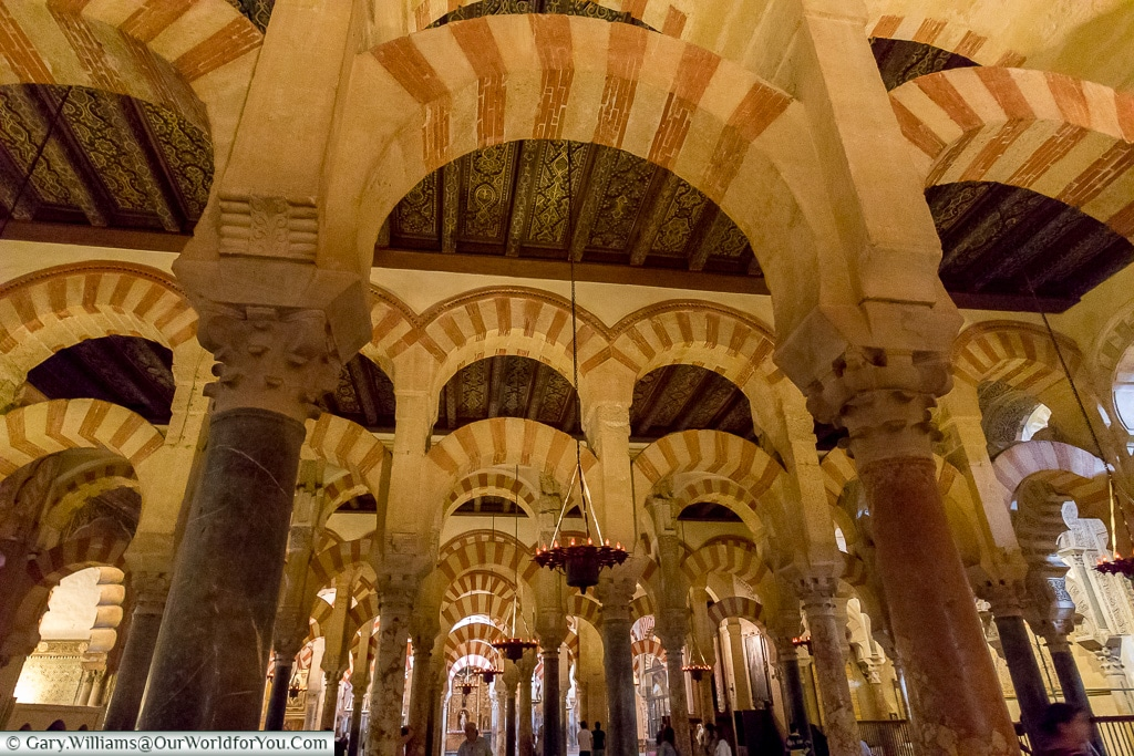 Admire the arches, Mezquita – Mosque–Cathedral, Córdoba, Sp