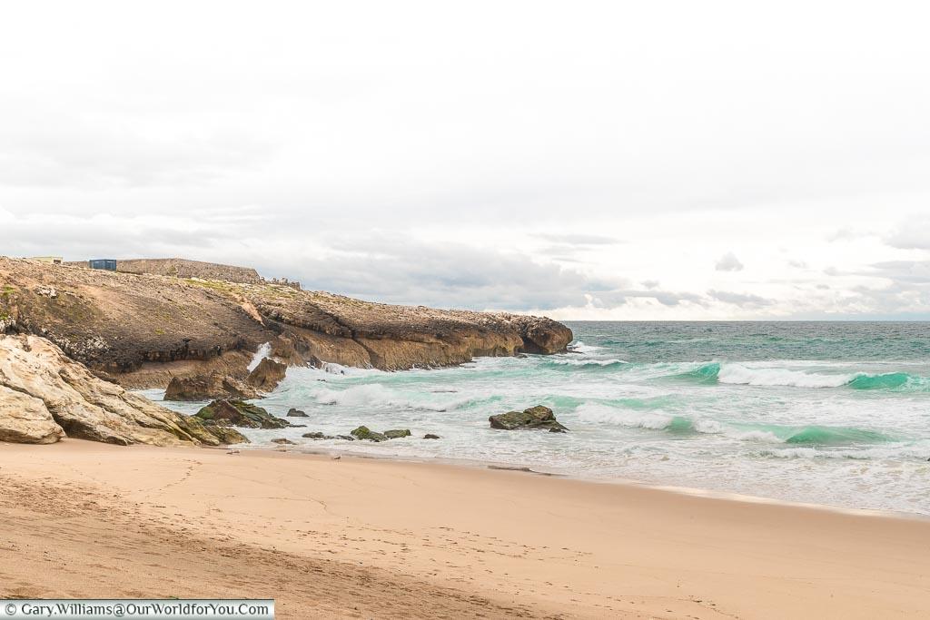 The sandy beaches of Praia da Cresmina, Portugal