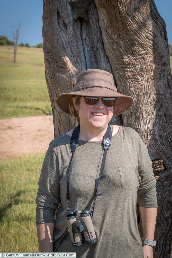 Janis behind the safety of a tree, Bush Walk, Rhino Safari Camp, Lake Kariba, Zimbabwe