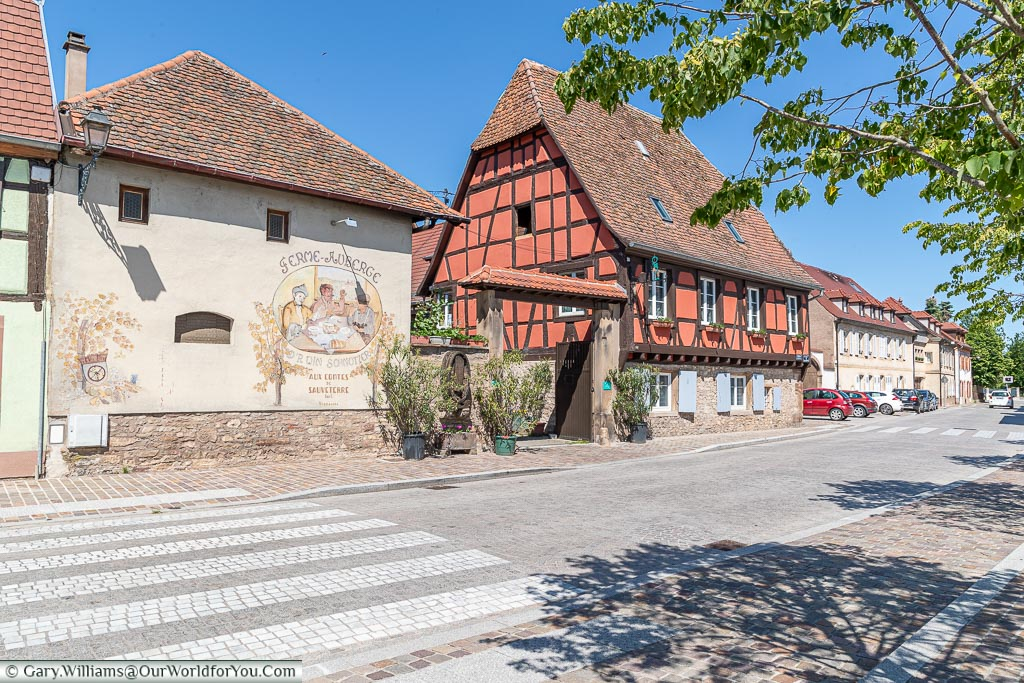 A roadside view of an Alsace Auberge - Vigneronne Winschnutzer.  The scene is a mix of French & German cultures that typify the Alsace region.