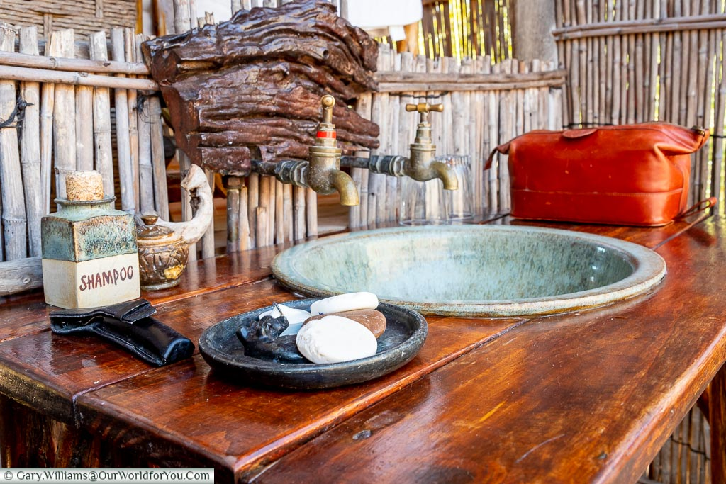 The open air wash stand in our lodge with a soap dish in the foreground.