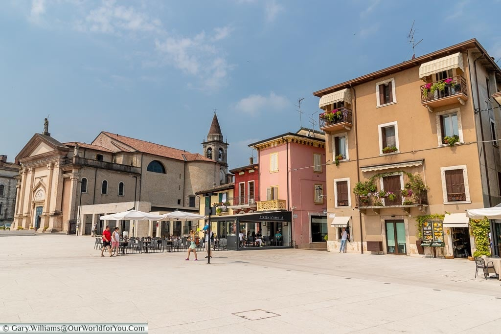 A scene from a piazza in front of the Duomo di San Martino, Peschiera del Garda.