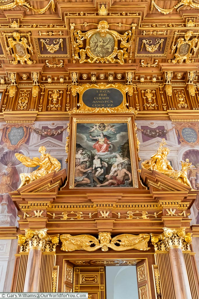 A decorated door of the Golden Hall with an ornate painting above it.