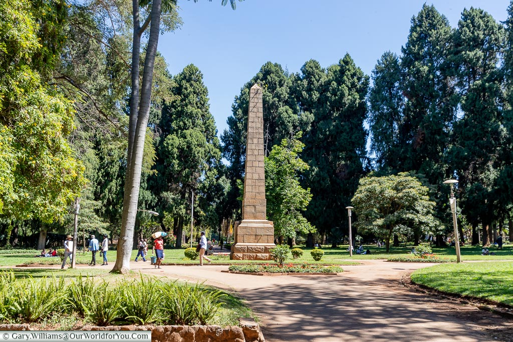 A large stone block obelisk in the centre of the Harare Gardens.