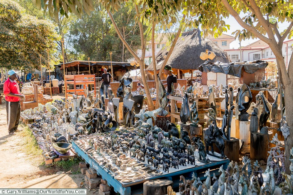 A collection of stalls displaying carved stone ornaments.