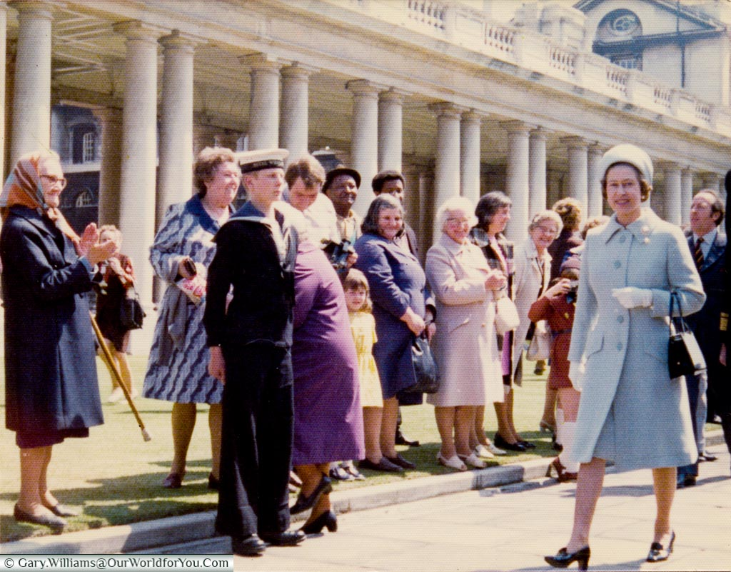 The Queen strolling through Greenwich Naval College in the '70's in front of a group of onllokers including me.