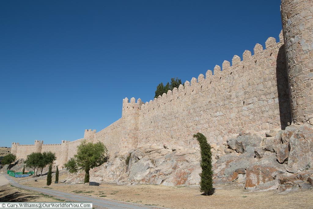 The exterior of old city walls of Ávila with 6 of its famous towers on show.