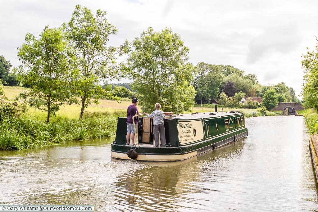 Moonbeam, our wide beam canal boat, heading along the Kennet and Avon canal at relaxing pace barging makes you adopt.
