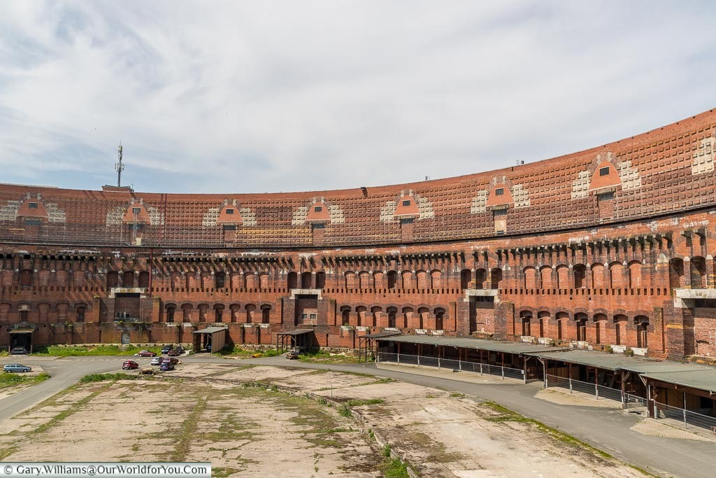 The red brick interior of the unfinished congress hall without a roof.
