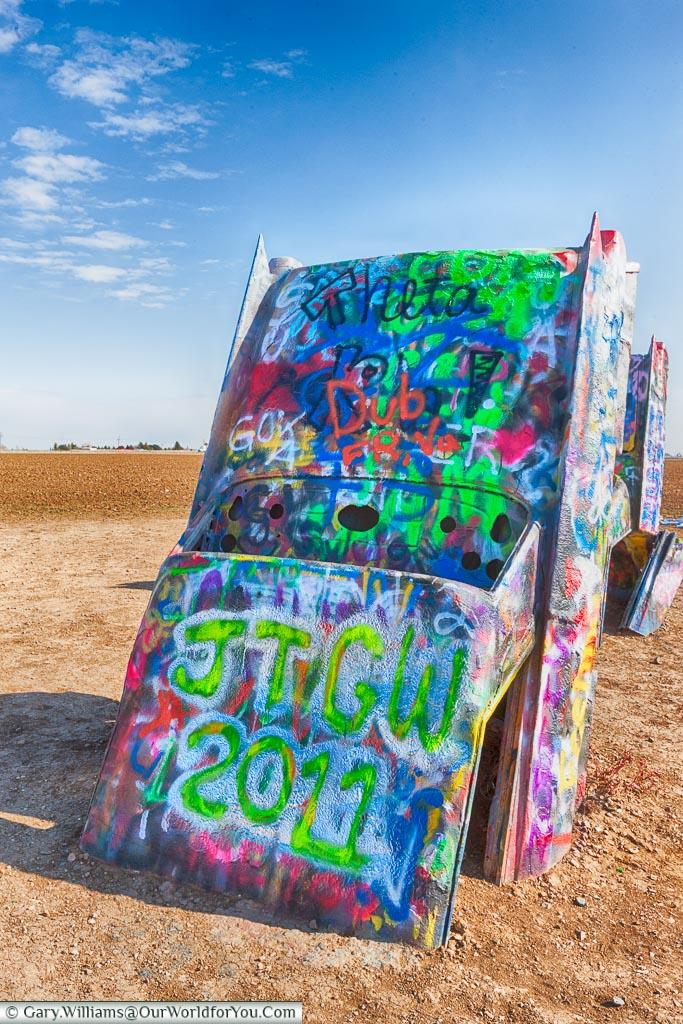 A cadillac tagged with our initals at the Cadillac Ranch