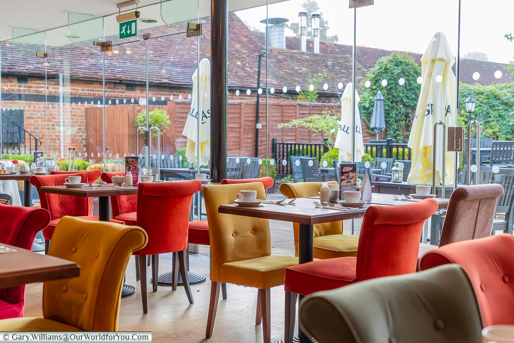 The brightly lit garden room at breakfast.