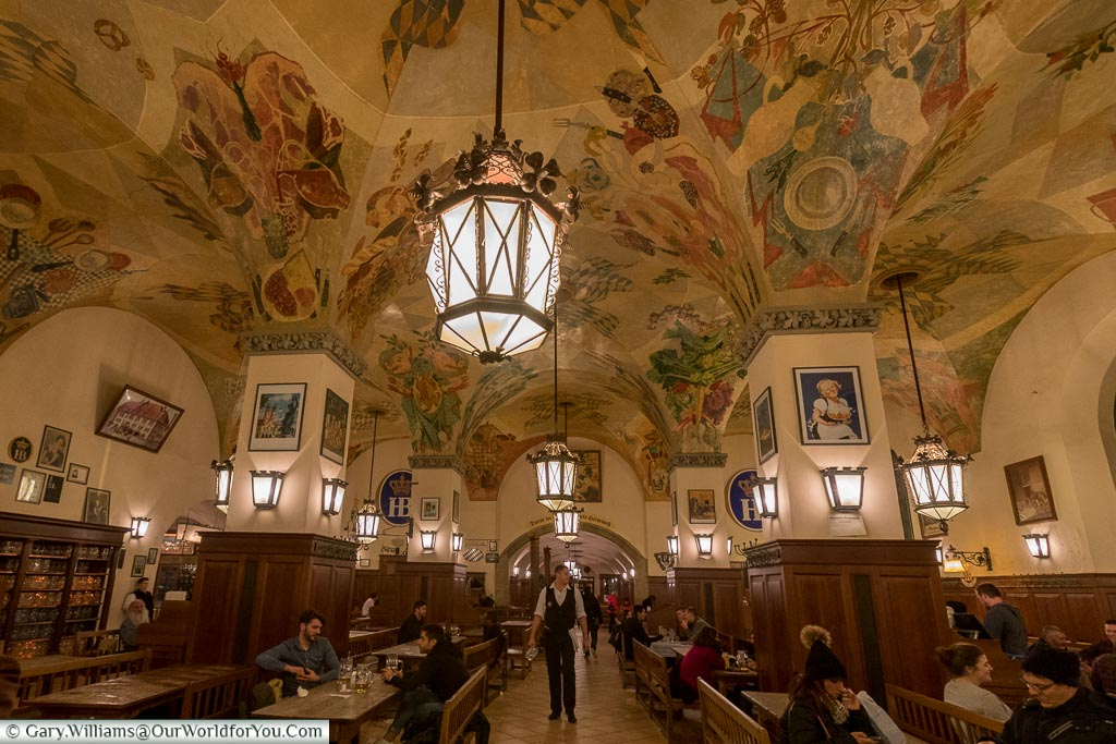 Looking up at the decorated vaulted ceiling of the Munich Hofbrauhaus at the end of the night.