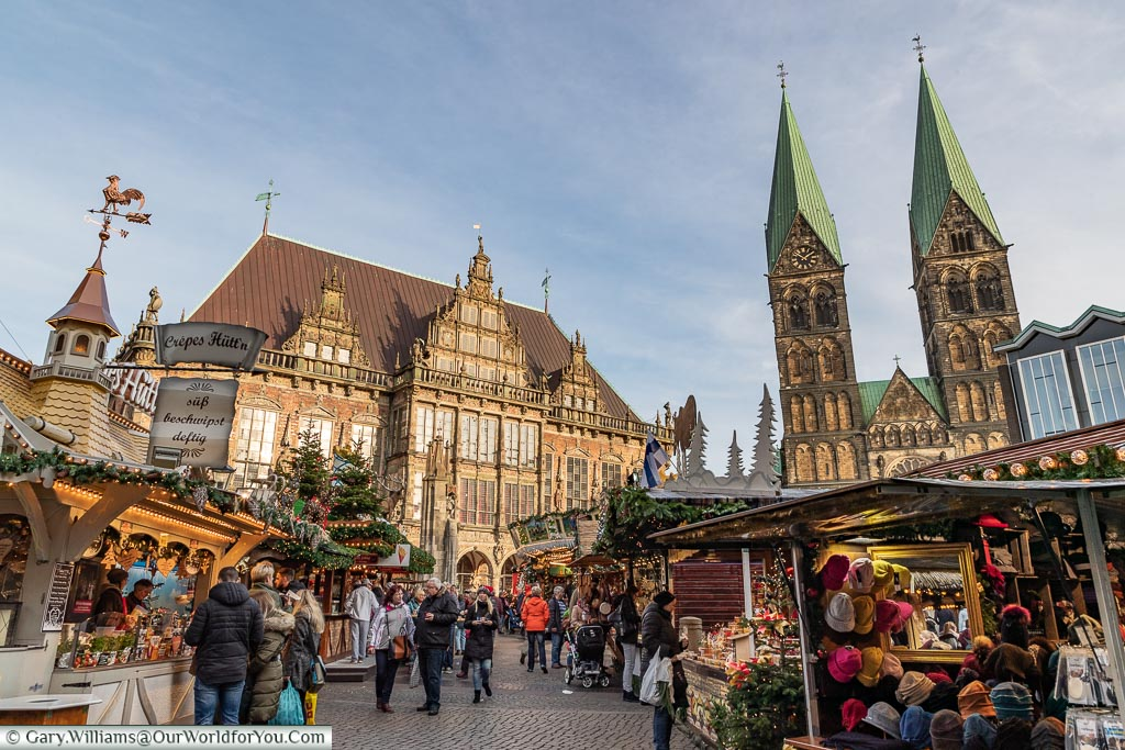 A view through the market in Bremen to the Rathaus and St. Petri Dom.
