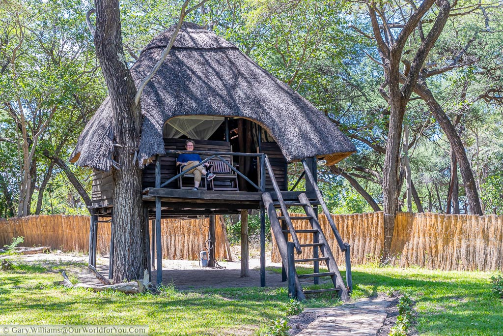 Janis sitting on the veranda of our tree lodge.  The thatched lodge is raised over 2 meters off the ground and made entirely of natural goods.  The 'windows' contain no glass, you're entirely open to the elements.