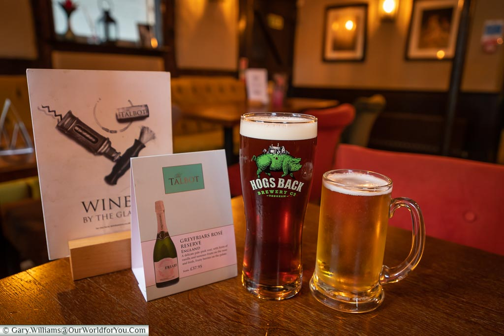 A pint of ale from the Hogs Back Brewery, just 12 miles from the Talbot Inn, and a half-pint of lager in the traditional area of the bar area.