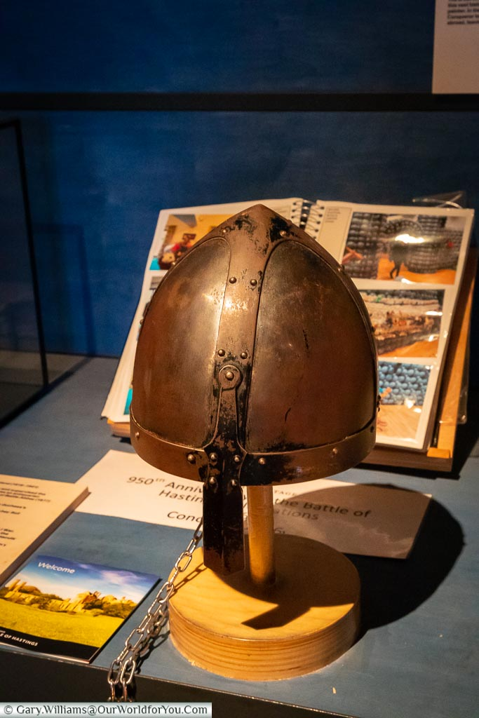 A display of a replica helmet worn by the Normans on a stand that can be tried on.