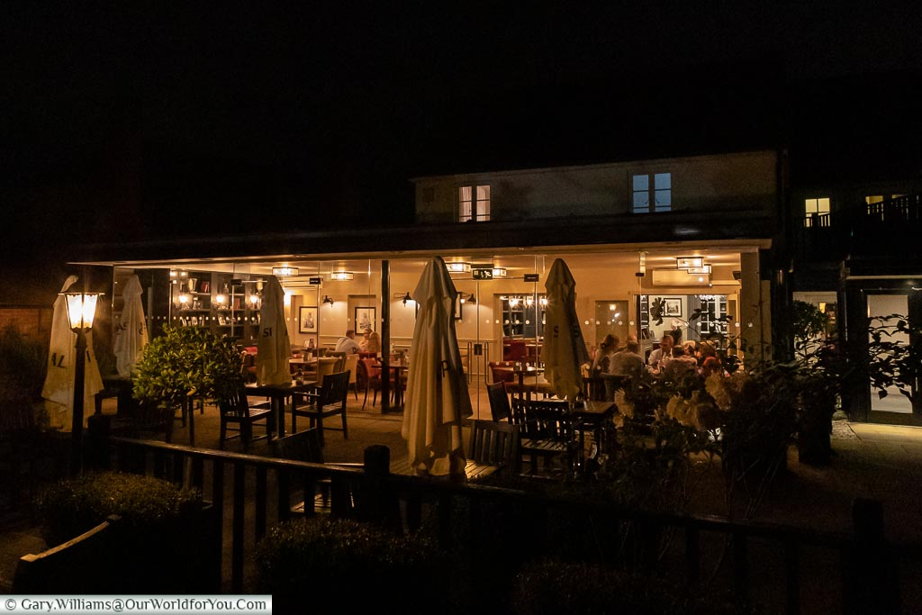 The Garden Room of the Talbot Inn at night.  A glass-fronted extension to the restaurant where diners can enjoy their food while overlooking the Inn's gardens.