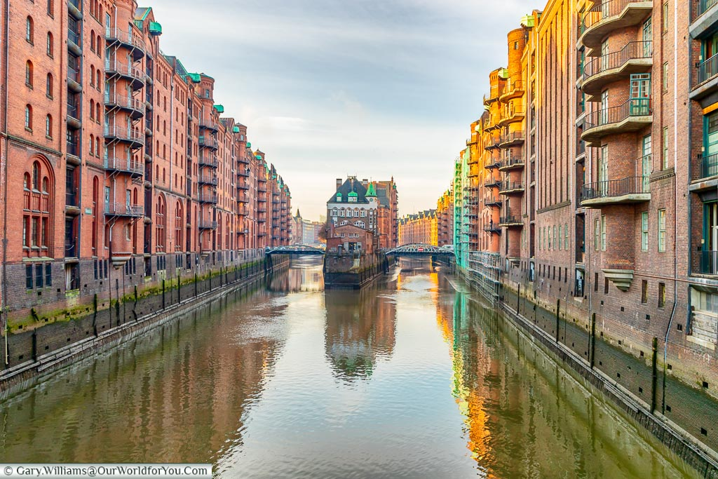 The canal between two rows of converted warehouses in the Speicherstadt district in Hamburg