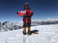 Near the summit of Ama Dablam, holding the Omani flag.