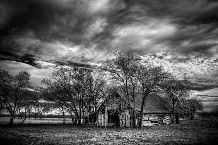 Keeping the exposure dark adds some drama to this photo of an old barn.