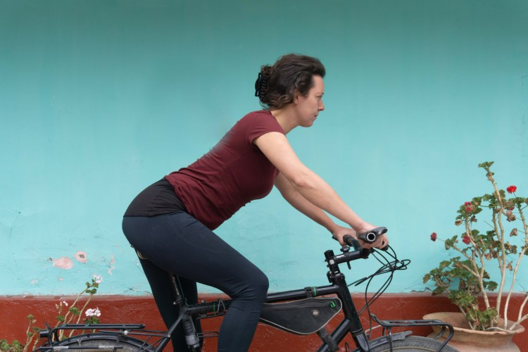 lower back pain from cycling over reaching position bike fit