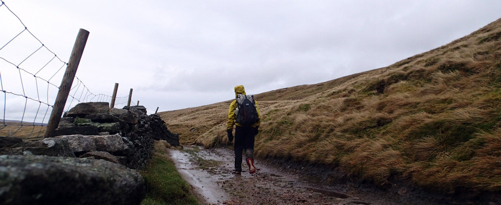 Walking the Pennine Way, hiding in my rain jacket, crossing the Yorkshire Dales