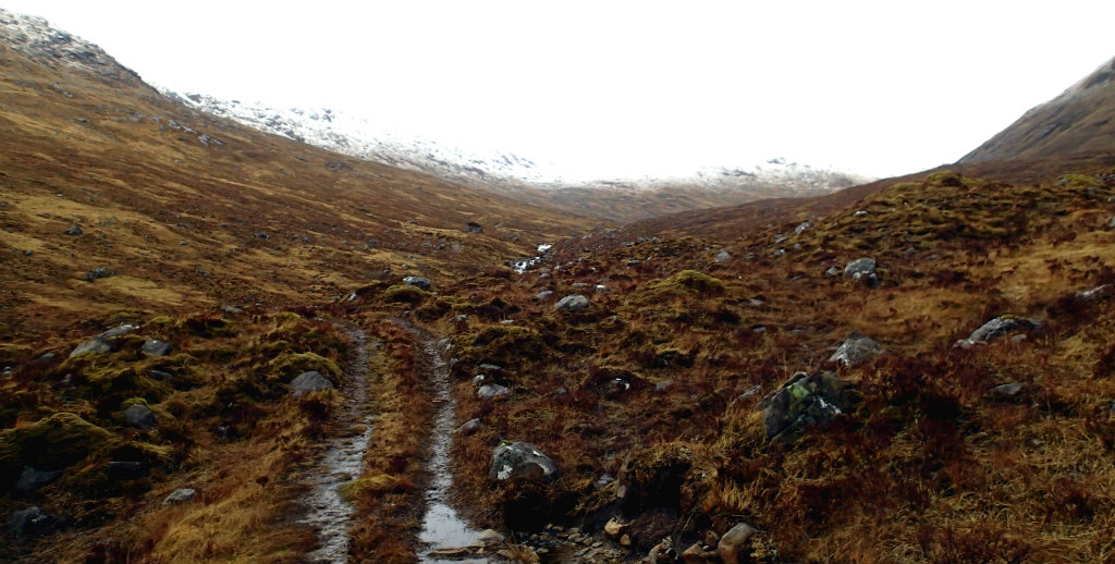 Heading to Allt Coire Mhalagain with the Saddle hiding behind low clouds