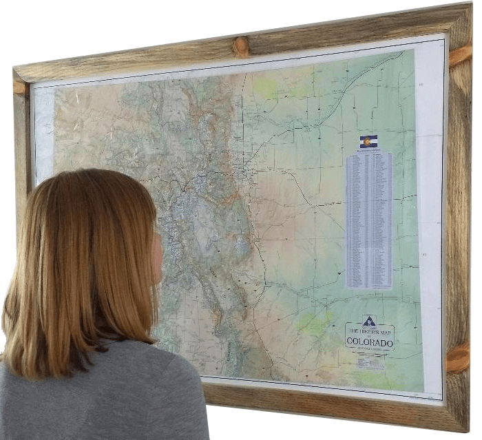 Model with framed Hikers Map of Colorado