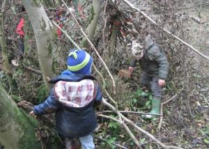 boys building den in woodland