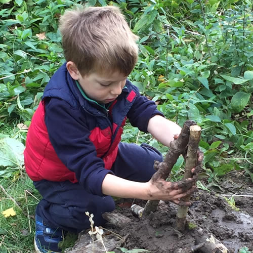 boy playing with mud