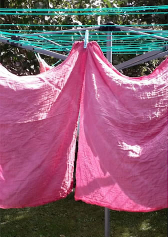 dyed sheets on washing line
