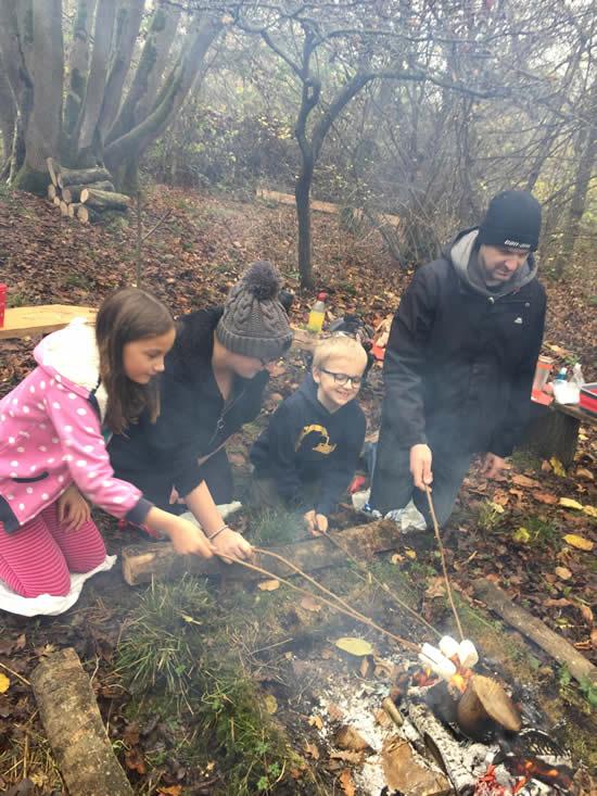 toasting marshmallows on an open fire