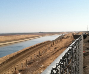 """Water in the California Aqueduct flowing south. According to Aquafornia, """"70 percent of California's runoff occurs north of Sacramento, 75 percent of California's urban and agricultural demands are to the south."""""""