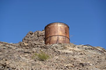 A water tower with beautiful rusty exterior