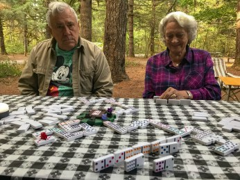 Bill and Barbara Playing Dominos before the crowd arrives for family campout McIver Park Estacada Oregon