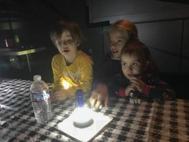Dice by flashlight Joshua, Addison & Willow (niece's kids)