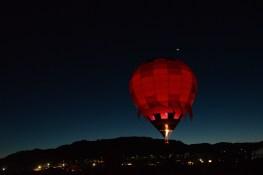 Dawn patrol launches while moon glows above the horizon