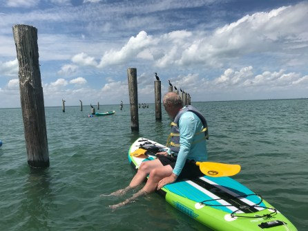 Tieing up to the pilings for snorkeling