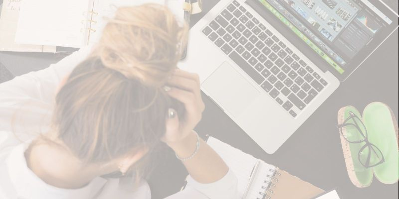Woman with head down frustrated and unhappy with her job so wants to resign from her job