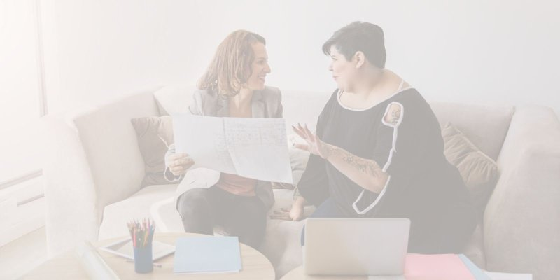 Two women at work talking and planning making the best use of their job change