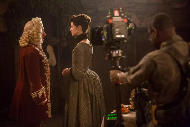 'Outlander' Season 1B  Behind the Scenes, Duke of Sandringham (Simon Callow) and Claire Randall Fraser (Caitriona Balfe)