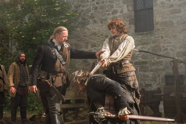 Douglas Henshall (Taran MacQuarrie) and Sam Heughan (Jamie Fraser)