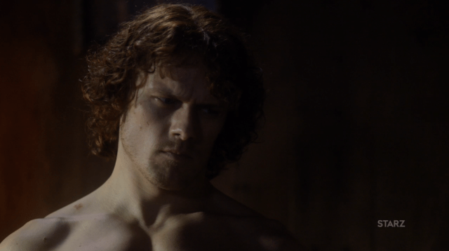 "Jamie's ""hard face"" as he says the Gaelic benediction over a sleeping Claire"