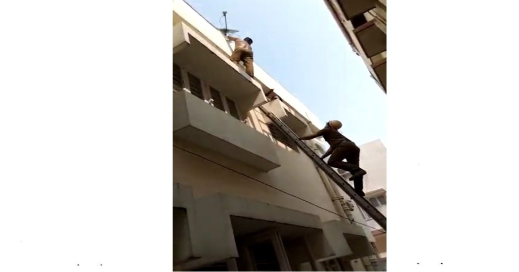 Firefighters rescued a mentally unbalanced person from the roof of the house