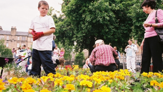 Community planting flowers in Dalmeny Street Park