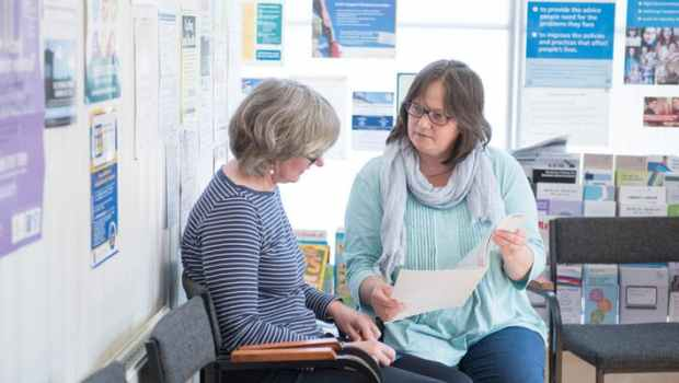 Citizens Advice Bureau Edinburgh adviser assisting someone