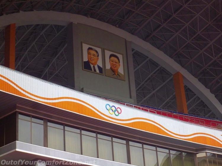 Kim family portraits may day stadium pyongyang North Korea