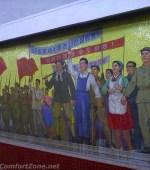 Pyongyang metro North Korea communist propaganda mural