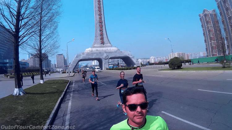 Rodrigo running past one of Pyongyang's many monuments during the 10K