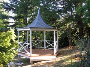 Timber gazebo with metal spired roof